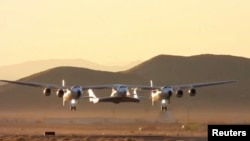 Virgin Galactic's carrier airplane WhiteKnightTwo carrying a space tourism rocket plane SpaceShipTwo takes off from Mojave Air and Space Port in Mojave, California, U.S. in a still image from video December 13, 2018.