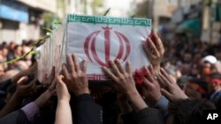 In this picture taken on March 29, 2015, and released by the semi-official Iranian Fars News Agency, a group of mourners carry the flag-draped coffin of Ali Yazdani, a member of Iran's Revolutionary Guard, whom the Guard says was killed during a U.S. drone strike near the Iraqi city of Tikrit.