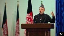 Afghan President Hamid Karzai speaks as he inaugurates Loya Jirga, grand assembly in Kabul, November 16, 2011.