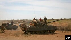 Somalia Al-Shabab's Resurgence: FILE - In this Wednesday, Feb. 29, 2012 file photo, Ethiopian military tanks sit in position on the outskirts of the town of Baidoa in Somalia.
