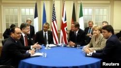 2014年9月4日美国总统奥巴马加入在威尔士纽波特凯尔特庄园度假村举行的关于乌克兰局势的北约峰会。领导人(自左起)分别是:法国总统弗朗索瓦·奥朗德,乌克兰总统波罗申科,奥巴马,英国首相戴维·卡梅伦,德国总理默克尔和意大利总理利马泰奥·伦齐。