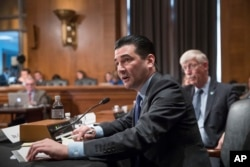 FILE - In this Oct. 5, 2017 file photo, Scott Gottlieb, commissioner of the Food and Drug Administration, answers a question from a Senate committee examining the federal response to the opioid addiction crisis, at the Capitol in Washington.