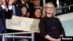 FILE - U.S. Secretary of State Hillary Clinton receives applause upon her departure from her last day in office at the State Department in Washington, D.C., Feb. 1, 2013. Clinton used a personal email account to conduct official business as secretary of state, according to the State Department.