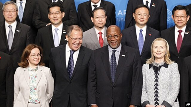 (front row) U.S. Secretary of State Hillary Clinton (R) and U.S. Trade Representative Ron Kirk (2nd R) pose with Russia's Foreign Minister Sergei Lavrov (2nd L) and Russian Minister of Economic Development Elvira Nabiullina (L) during the APEC Ministerial