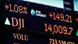 A board on the floor of the New York Stock Exchange shows the closing number for the Dow Jones industrial average, February 1, 2013.