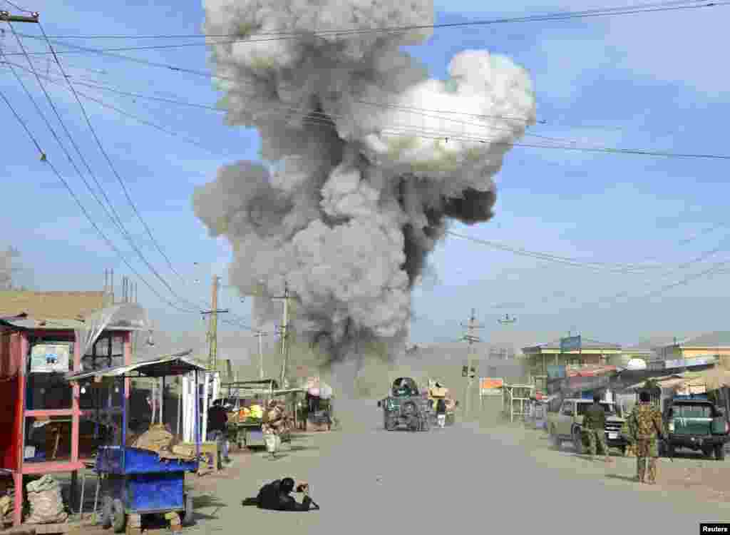 Smoke rises in the sky after a suicide car bomb attack in Kunduz province. Taliban insurgents launched an attack on a police headquarters in northern Afghanistan, provincial police spokesman Sayed Sarwar Hosseini said.