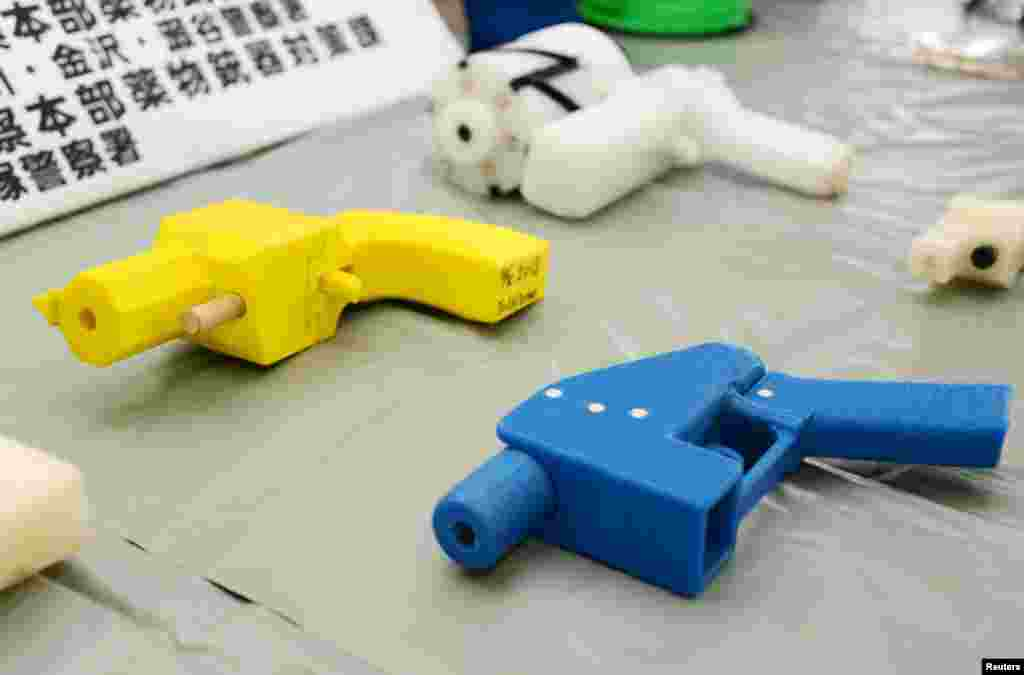 Seized plastic handguns created, using 3D printing technology, are displayed at Kanagawa police station in Yokohama, south of Tokyo, Japan.