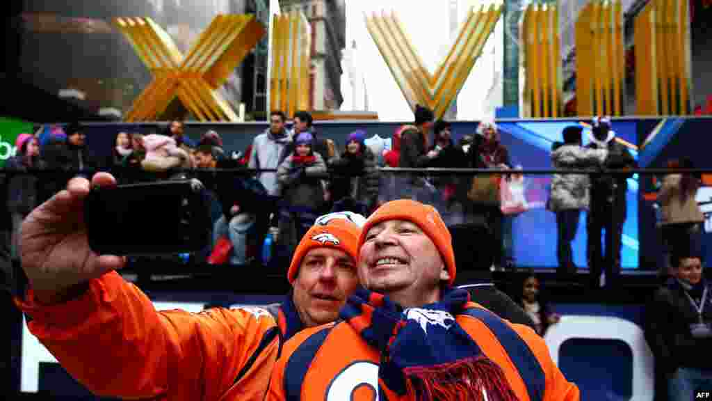 Fans Todd Barnes and Mitch Daniels photograph themselves on Super Bowl Boulevard in Times Square prior to Super Bowl XLVIII, Jan. 31, 2014, in New York City.