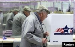 FILE - Henry Martin, 80, votes in Chicago, Illinois, Nov. 2, 2004.