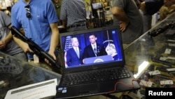 Gun customers watch video Obama gun control announcement, Bullet Hole gun shop, Sarasota, Florida, Jan. 16, 2013.