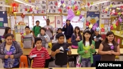 In this photo taken on Tuesday, April 20, 2010, Cedar Lane Middle School students take a Chinese Language and Culture class in the Hacienda Heights area of Los Angeles. (AP Photo/Damian Dovarganes)