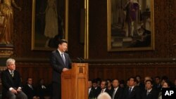 China's President Xi Jinping addresses members of parliament and peers in Parliament's Royal Gallery, in London, England, Oct. 20, 2015.