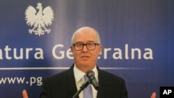 FILE - Poland's Prosecutor General Andrzej Seremet tells a news conference in Warsaw, June 19, 2014.
