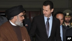 FILE -- Hezbollah leader sheik Hassan Nasrallah, left, speaks with Syrian President Bashar Assad on Feb 25, 2010. (AP Photo/SANA)