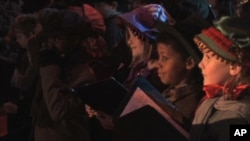 "Children in London perform for the premiere for the latest movie version of Charles Dickens' ""A Christmas Carol"""