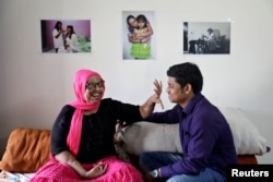 "Pramodini Roul, 24, an acid attack survivor and a campaigner at Chhanv, an NGO that supports acid attack victims, and her partner Saroj Sahoo, 26, a manager at Chhanv, share a moment at the ""Sheroes"" home for acid attack victims in Noida, India, Feb. 8, 2018."