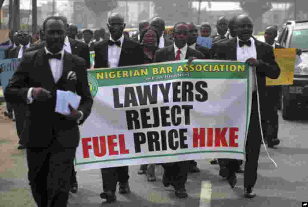 Members of the Nigerian Bar Association carry a banner as they walk along a street to protest a fuel subsidy removal, in Lagos January 5, 2012. Nigerian trade unions threatened on Wednesday to call a national strike and shut down large parts of the countr