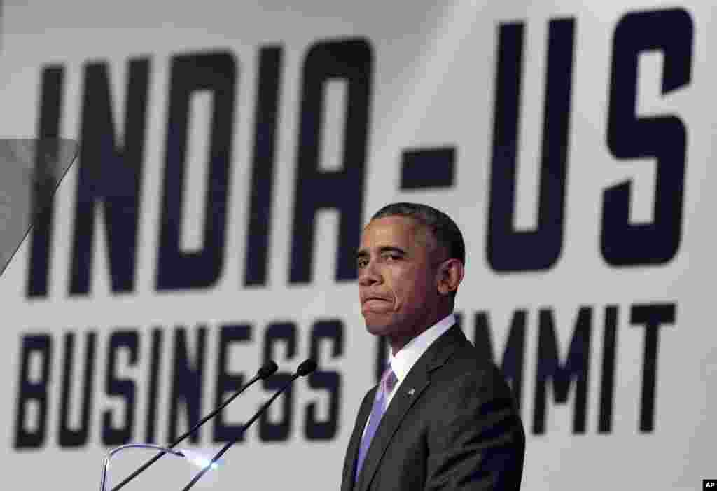 U.S President Barack Obama pauses as he speaks at the CEO Summit at theTaj Palace Hotel in New Delhi, India, Monday, Jan. 26, 2015.