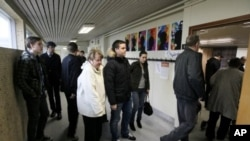 People queue to vote in the Icesave referendum in Reykjavik, Iceland, April 9, 2011