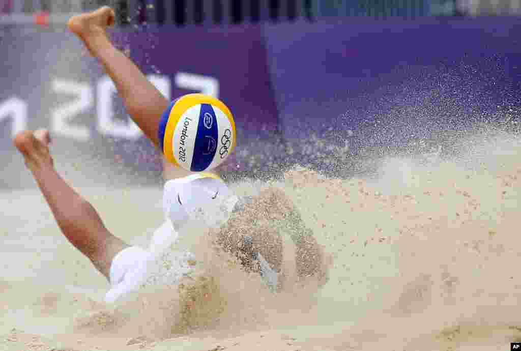Spain's Pablo Herrera Allepuz misses the ball during a beach volleyball match against Japan.