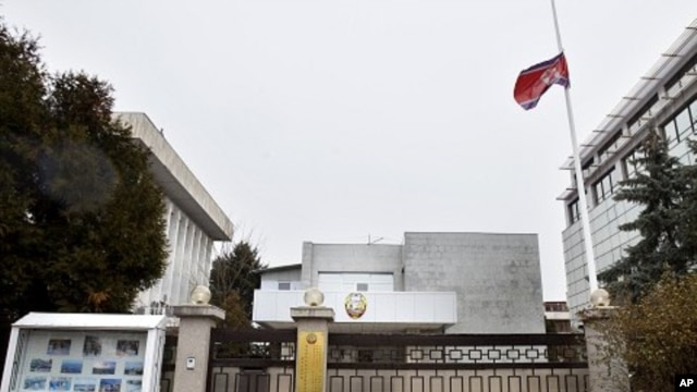 The flag of North Korea flies at half-staff at the North Korean Embassy in Bucharest, Romania, December 19, 2011.