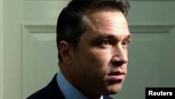 U.S. Representative Michael Grimm talks to reporters outside his office on Capitol Hill in Washington, April 29, 2014.