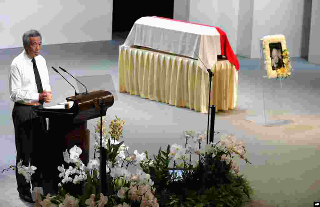 Singapore's Prime Minister Lee Hsien Loong, delivers his eulogy during a state funeral of his father, held at the University Cultural Center, March 29, 2015.