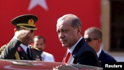 Turkey's President Recep Tayyip Erdogan looks on during his visit to northern Cyprus, July 20, 2015.