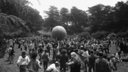 Hippies gather in San Francisco's Golden Gate Park in June 1967 to celebrate the start of summer. Here they keep a large ball, painted to represent a world globe, in the air.