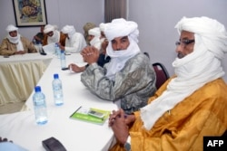 FILE - Ethnic Tuareg and Arab militias from Mali meet on Aug. 28, 2014 in Ouagadougou, Burkina Faso, to talk about a homeland in northern Mali (called Azawad) they lay claim on, ahead of peace negotiations with the government.