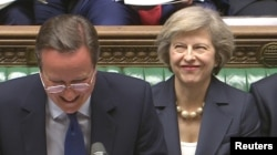 Britain's outgoing Prime Minister, David Cameron (C), incoming prime minister Theresa May (R) and Chancellor of the Exchequer George Osborne, laugh during Prime Minister's Questions in the House of Commons, in central London, Britain on July 13, 2016.