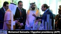 Egyptian President Abdel-Fattah el-Sissi, right, and Prime Minister of the United Arab Emirates (UAE) and Sheikh Mohammed bin Rashid al-Maktoum, center, look at a model of the new Egyptian capital Cairo displayed at the Egypt Economic Conference, March 14, 2015.