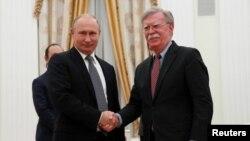 Владимир Путин и Джон Болтон. Москва, Россия. 23 октября 2018 г.