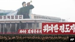 "North Korean soldiers applaud near signs from left which reads ""revolutionary spirit,"" ""Great leader comrade Kim Jong Un"" and ""Great leader"" during a mass rally in Kim Il Sung Square in Pyongyang, North Korea, December 14, 2012."