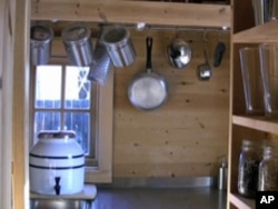 The kitchen in Jay Shafer's tiny home includes a small gas stove and sink .