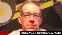 J. Kevin White wearing his glasses. White has developed a system to provide eye testing and glasses to people in developing nations.
