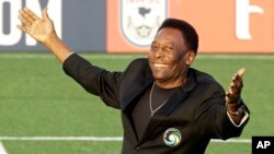 FILE - Brazilian soccer legend Pele waves to the crowd during a pregame ceremony before an NASL soccer game in Hempstead, New York, Aug. 3, 2013.