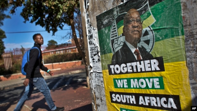A man walks past an election poster of Jacob Zuma's African National Congress (ANC) party in the Soweto township of Johannesburg, South Africa Friday, May 9, 2014.