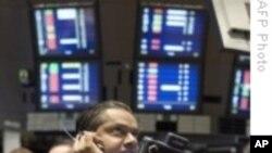 As Dollar Slides, Gold Soars