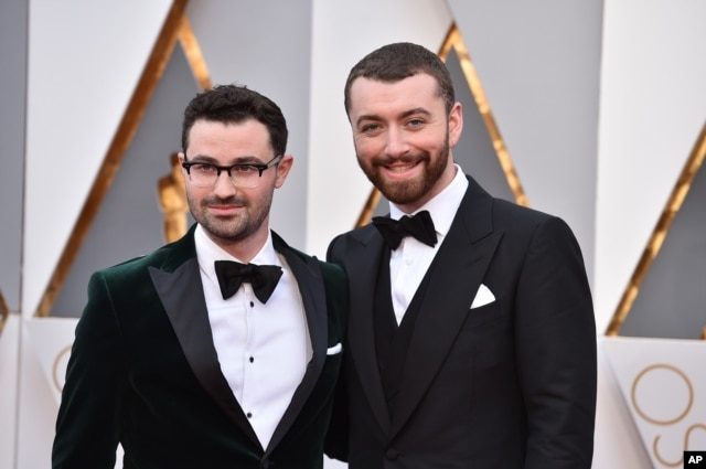 Sam Smith, right, and Jimmy Napes arrive at the Oscars on Feb. 28, 2016, at the Dolby Theatre in Los Angeles.