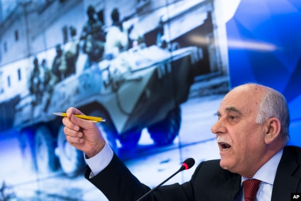 General Mustafa Al-Sheikh, former head of the Free Syrian Army and the head of a Syrian opposition delegation visiting Moscow, gestures while speaking to reporters in Moscow, Jan. 13, 2017. Al-Sheikh commented on the planned Syria peace conference in Astana, saying its main goal is to secure a lasting cease-fire in Syria and prepare talks in Geneva on Syria political settlement.