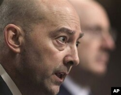 FILE - Adm. James Stavridis, NATO's supreme allied commander in Europe, testifies on Capitol Hill in Washington, March 29, 2011, before the Senate Armed Services Committee hearing.