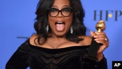 Oprah Winfrey poses in the press room with the Cecil B. DeMille Award at the 75th annual Golden Globe Awards Jan. 7, 2018, in Beverly Hills, Calif.