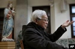Retired archbishop of Hong Kong Cardinal Joseph Zen gestures during an interview in Hong Kong, Friday, Feb. 9, 2018.