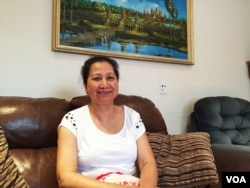 Kang Sopha, a 70-year-old, retired Cambodian resident of Oakland who has voted by mail in California's primary elections in June talks to VOA Khmer at her home, September 7, 2016. Although she became a US citizenship in 2005, Kang Sopha has not voted in the last two presidential elections. The Oakland resident is finally voting in this year's presidential election, by mail. (Sophat Soeung/VOA Khmer)