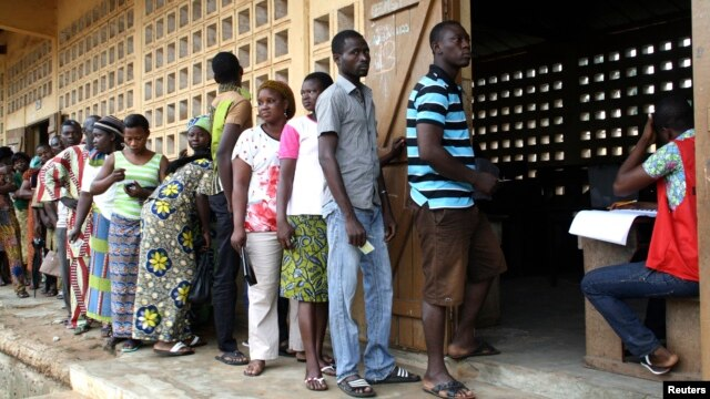 Voters are seen lining up to cast their ballots in Lome, Togo, July 25, 2013.