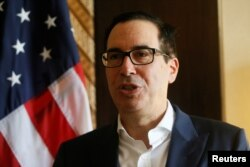 United States Secretary of the Treasury Steven Mnuchin speaks during an interview with Reuters at the International Monetary Fund - World Bank Annual Meeting 2018 in Nusa Dua, Bali, Indonesia, Oct. 12, 2018.