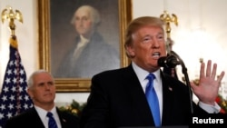 U.S. Vice President Mike Pence listens as U.S. President Donald Trump announces that the United States recognizes Jerusalem as the capital of Israel and will move its embassy there, during an address from the White House, Dec. 6, 2017.