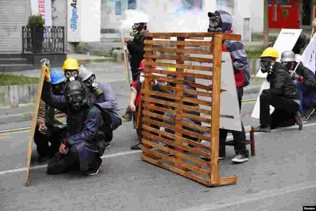 Protester shield themselves from police during a May Day demonstration in Istanbul, Turkey.