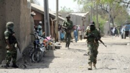 Nigerian soldiers are seen patrolling a town in Borno state, April 30, 2013.